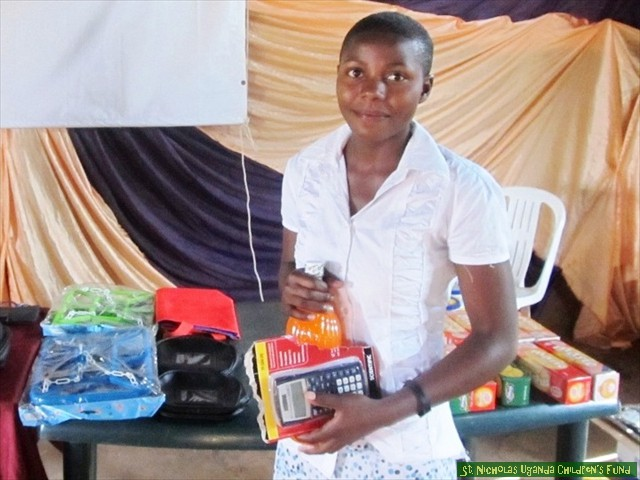Hilda, one of our top students, selects her rewards for academic performance.